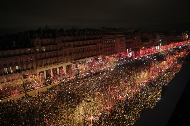 Spectators gather to attend the New Year's Day celebrations on the Champs-Elysees, in Paris