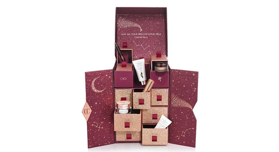 """<p>Charlotte Tilbury's highly-anticipated beauty advent calendar features 12 miniature award-winning beauty saviours from the make-up artist's now-famous miracle cream to a must-have clay mask. Available online <a href=""""http://www.charlottetilbury.com/uk/charlottes-beauty-universe-advent-calendar.html?istCompanyId=3dfffc45-1529-45a3-a883-dba601d7c955&istItemId=-xtrwqiqpiw&istBid=tzrt&gclid=Cj0KCQjw6rXeBRD3ARIsAD9ni9C-_SfcwSEYKJ6imMB9s8-xUnoXCuT2ssGTryWwPAXP9CwIbNkRdSUaAivMEALw_wcB&gclsrc=aw.ds&dclid=COievcWgmt4CFYjC3godYRUCYw&ranMID=40203&utm_source=RAN&utm_medium=Affiliate&utm_campaign=TnL5HPStwNw&publisher=2116208:Skimlinks.com&linkType=10&linkName=&offerName=Skimlinks+baseline&ranEAID=TnL5HPStwNw&ranSiteID=TnL5HPStwNw-YCxzLXzQ_L8StckEyCdF5Q&siteID=TnL5HPStwNw-YCxzLXzQ_L8StckEyCdF5Q"""" rel=""""nofollow noopener"""" target=""""_blank"""" data-ylk=""""slk:now"""" class=""""link rapid-noclick-resp"""">now</a> for £150. </p>"""