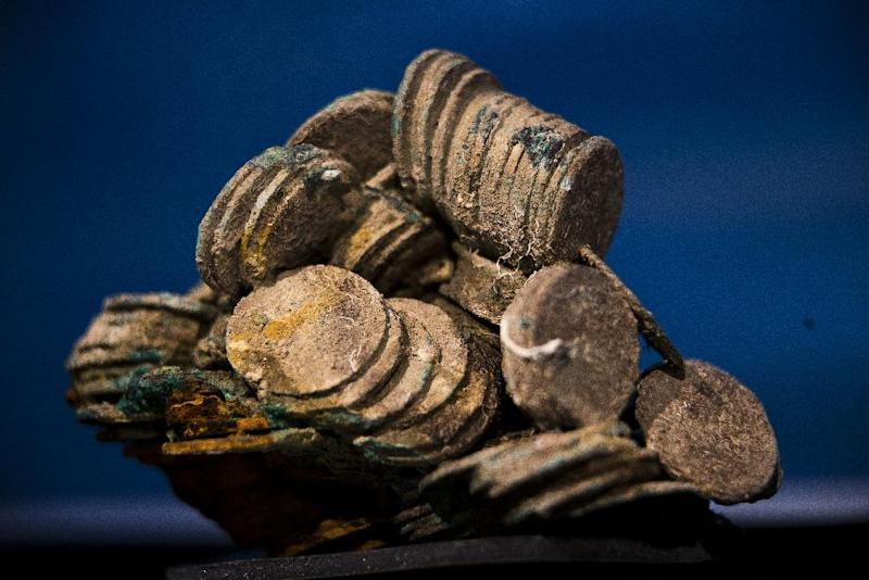 A block of encrusted silver coins from the shipwreck of a 1804 galleon, on its first display to the media at a Ministry building, in Madrid, Friday, Nov. 30, 2012. Spanish cultural officials have allowed the first peep at 16 tons (14.5 metric tons) of the shipwreck, 'Nuestra Senora de las Mercedes' a treasure worth an estimated $500 million that a U.S. salvage company gave up after a five-year international ownership dispute. (AP Photo/Daniel Ochoa de Olza)