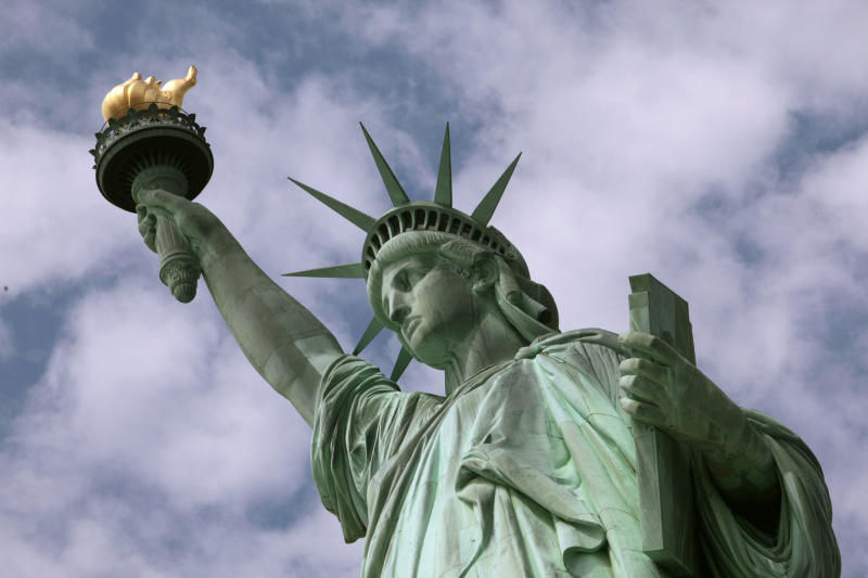 FILE - In this June 2, 2009, file photo, the Statue of Liberty stands in New York harbor. (AP Photo/Richard Drew, File)