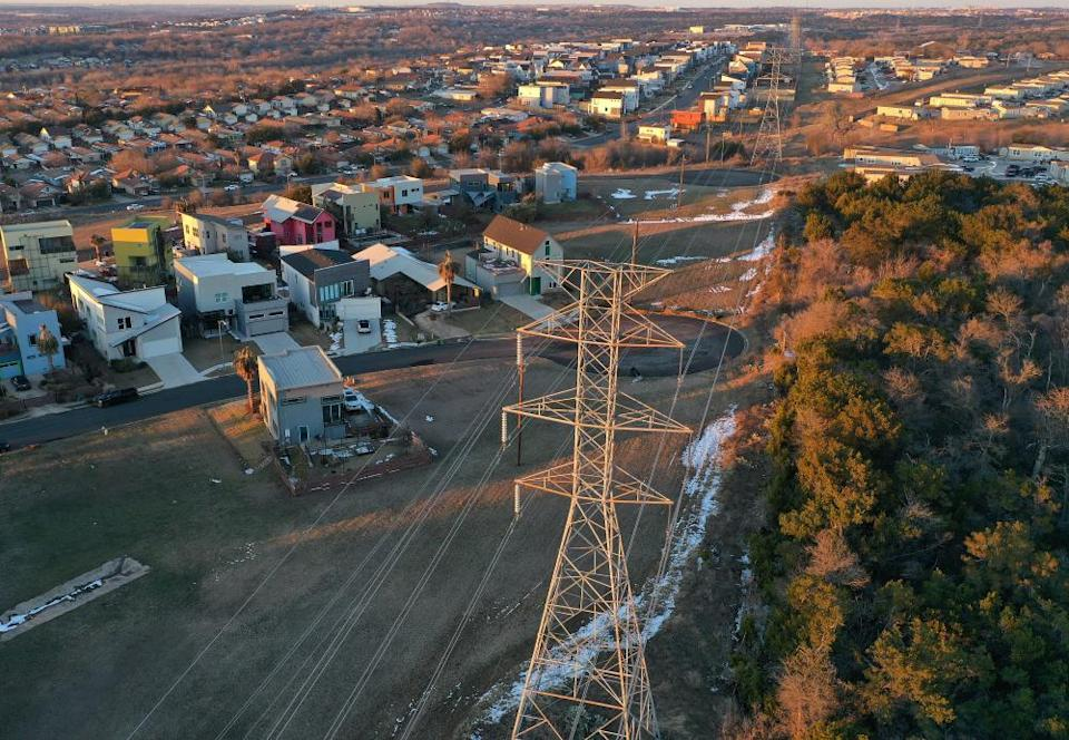 An aerial view of homes, buildings and electrical lines running through an Austin neighborhood on 19 February.