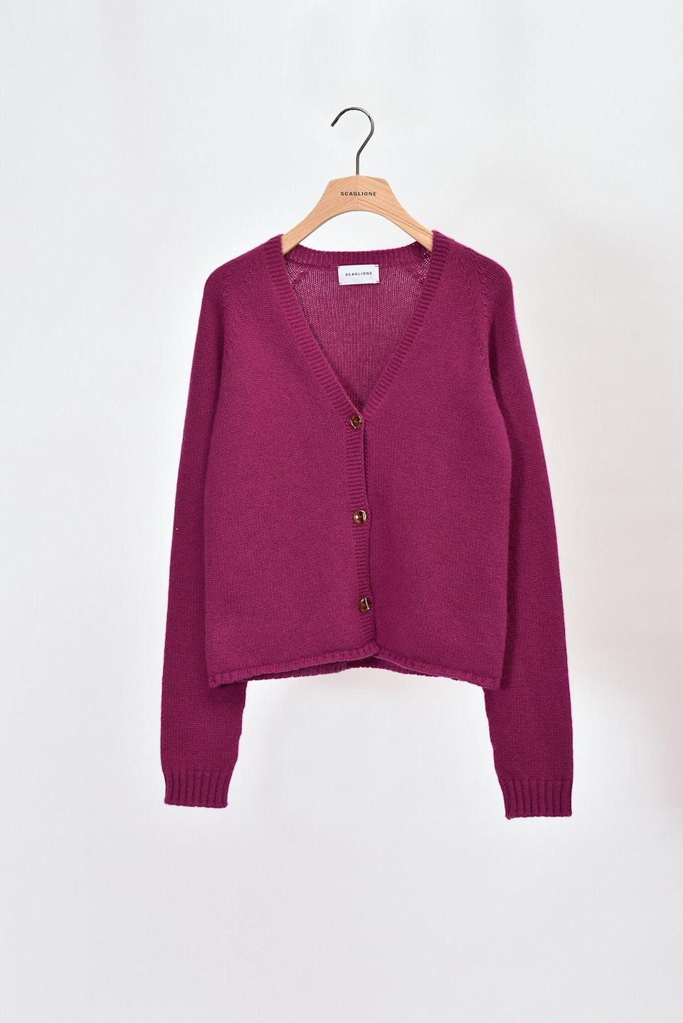 """<p>""""I toss this <span>seamless cardigan from Scaglione</span> ($285) over my looks because it's winter, and cashmere always feel like a big hug and a treat. I have a lot of cream, camel, and beige knits that are already my go-tos, but this rich jewel tone just cheers me up.""""</p>"""