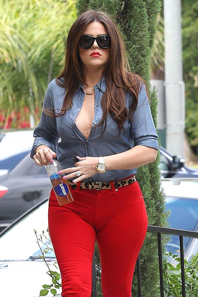"We love the Kardashians for embracing their curves, but this unfortunate pair of too-tight red pants didn't exactly flatter Khloe's figure. Sam Sharma/<a href=""http://www.pacificcoastnews.com/"" target=""new"">PacificCoastNews.com</a> - May 18, 2011"
