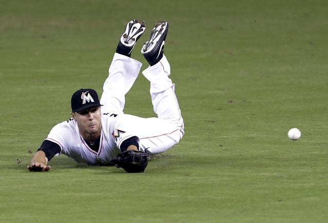 Miami Marlins center fielder Jake Marisnick dives for a ball hit by Cleveland Indians' Asdrubal Cabrera in the fifth inning, which was good for a single, during an interleague baseball game, Saturday, Aug. 3, 2013, in Miami. (AP Photo/Lynne Sladky)
