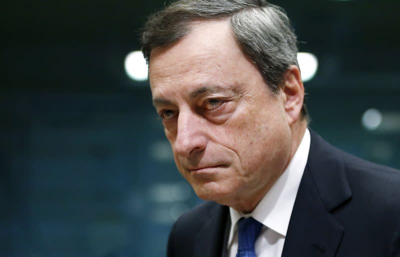 European Central Bank (ECB) President Mario Draghi looks on at the start of a euro zone finance ministers meeting in Brussels