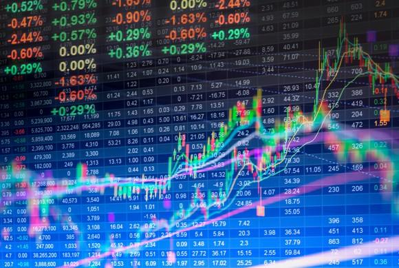 Colorful stock market data and charts on an LED display