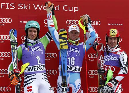 Felix Neureuther of Germany, Alexis Pinturault of France and and Marcel Hirscher of Austria (L-R) celebrate on the winners podium after the men's World Cup slalom ski race in Wengen January 19, 2014. REUTERS/Ruben Sprich