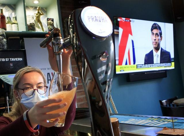 An employee pulls a pint in the Tib Street Tavern in Manchester, as Chancellor of the Exchequer Rishi Sunak announces the government will pay two thirds of the wages of staff in pubs, restaurants and other businesses if they are forced to close under new coronavirus restrictions. Cities in northern England and other areas suffering a surge in Covid-19 cases may have pubs and restaurants temporarily closed to combat the spread of the virus