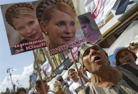 Supporters of jailed former Ukrainian PM and opposition leader Tymoshenko hold portraits of her during a rally in central Kiev