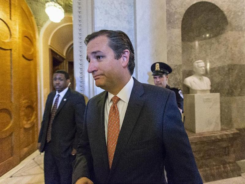 """Sen. Ted Cruz, R-Texas leaves the floor of the Senate on Capitol Hill in Washington, Monday, Sept. 23, 2013, after a testy exchange with Senate Majority Leader Harry Reid, D-Nev., at the start of legislative business. Cruz and fellow tea party conservatives on Sunday said President Barack Obama and his Democratic allies would be to blame if they don't accede to GOP demands to strike down the national health care law. Conservatives in the House on Friday approved legislation to keep the government running but at the cost of wiping out the Affordable Care Act, popularly known at """"Obamacare."""" (AP Photo/J. Scott Applewhite)"""