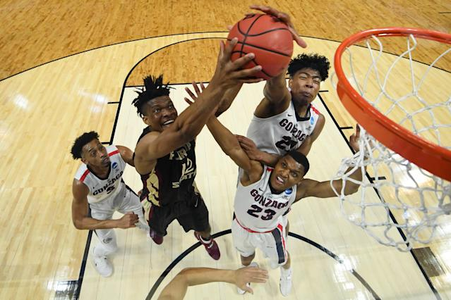 <p>Florida State Seminoles center Ike Obiagu #12 goes up for the rebound in front of Gonzaga Bulldogs forward Rui Hachimura #21 during the third round of the 2018 NCAA Men's Basketball Tournament held at Staples Center on March 22, 2018 in Los Angeles, California. (Photo by Jamie Schwaberow/NCAA Photos via Getty Images) </p>