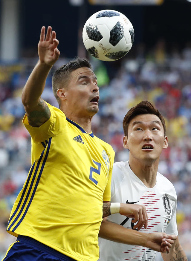 Sweden's Mikael Lustig, left, and South Korea's Jang Hyun-soo battle for the ball during the group F match between Sweden and South Korea at the 2018 soccer World Cup in the Nizhny Novgorod stadium in Nizhny Novgorod, Russia, Monday, June 18, 2018. (AP Photo/Pavel Golovkin)
