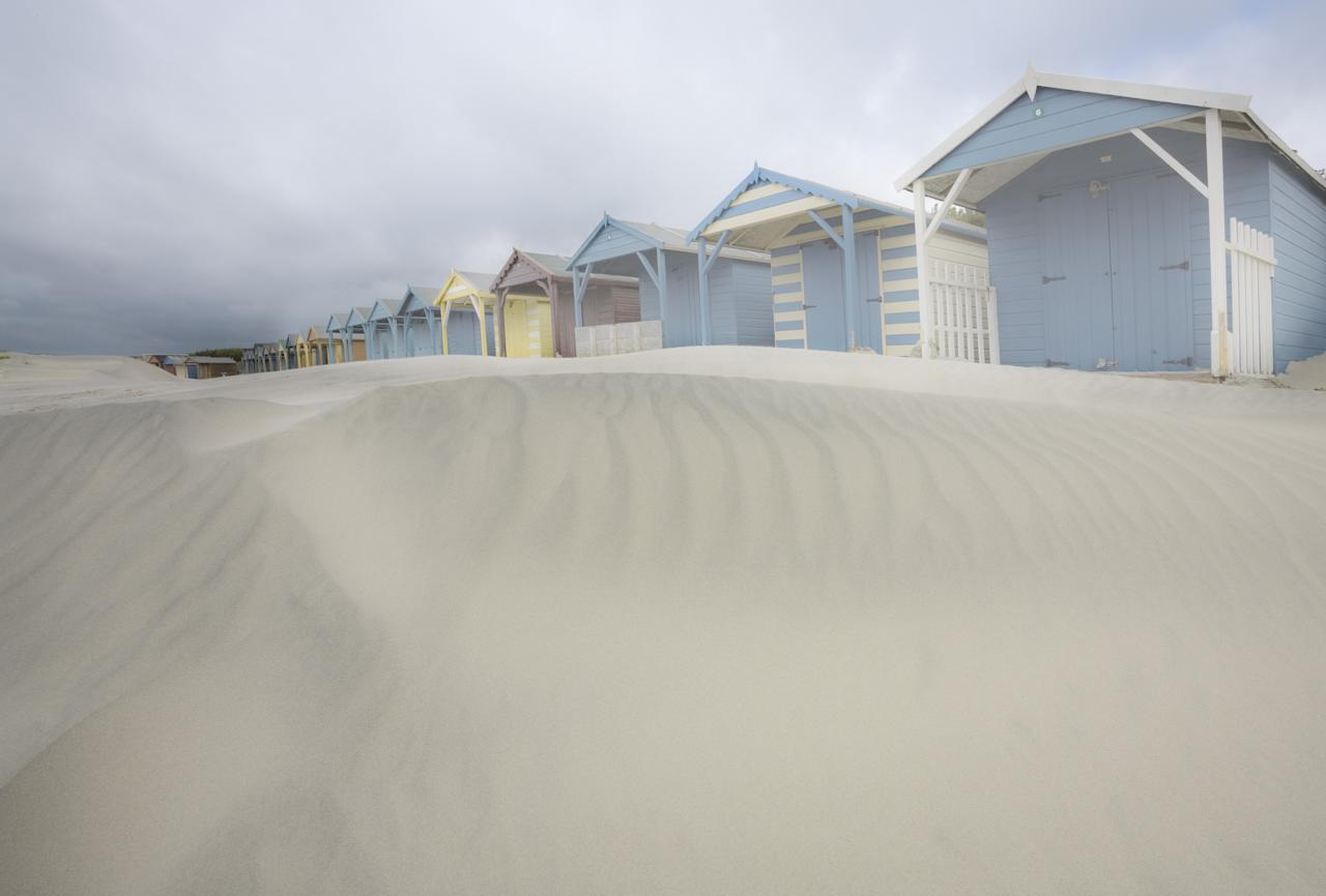 'Beach Huts at West Wittering', West Sussex: A dull and drizzly day in October was the setting for Jean Brooks when she took this picture of the sand blown into rippled dunes. (Jean Brooks, Landscape Photographer of the Year)