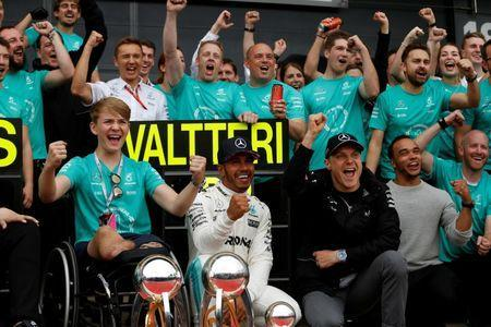 F1 - Formula One - British Grand Prix 2017 - Silverstone, Britain - July 16, 2017 Mercedes' Lewis Hamilton celebrates his win with Valtteri Bottas (R), Billy Monger (L) and his team REUTERS/Andrew Boyers