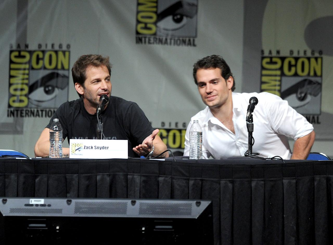 """SAN DIEGO, CA - JULY 14:  Director Zack Snyder (L) and actor Henry Cavill speak at Warner Bros. Pictures and Legendary Pictures preview """"Man Of Steel"""" during Comic-Con International 2012 at San Diego Convention Center on July 14, 2012 in San Diego, California.  (Photo by Kevin Winter/Getty Images)"""