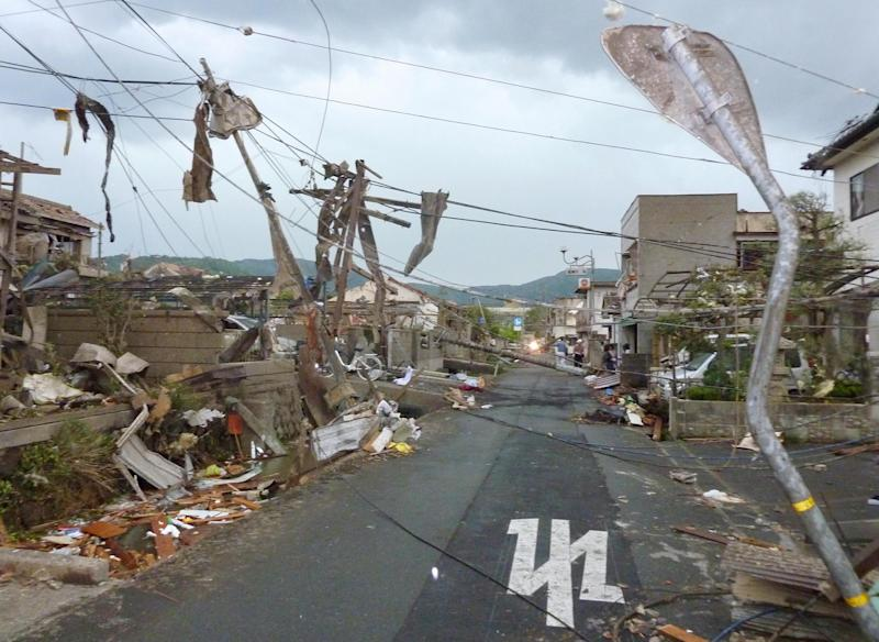 A damaged residential area is seen after a tornado struck Tsukuba city, northeast of Tokyo, Sunday, May 6, 2012. The tornado tore through the area, injuring at least 30 people, destroying dozens of homes and leaving thousands more without electricity. (AP Photo/Kyodo News) JAPAN OUT, MANDATORY CREDIT, NO LICENSING IN CHINA, HONG KONG, JAPAN, SOUTH KOREA AND FRANCE