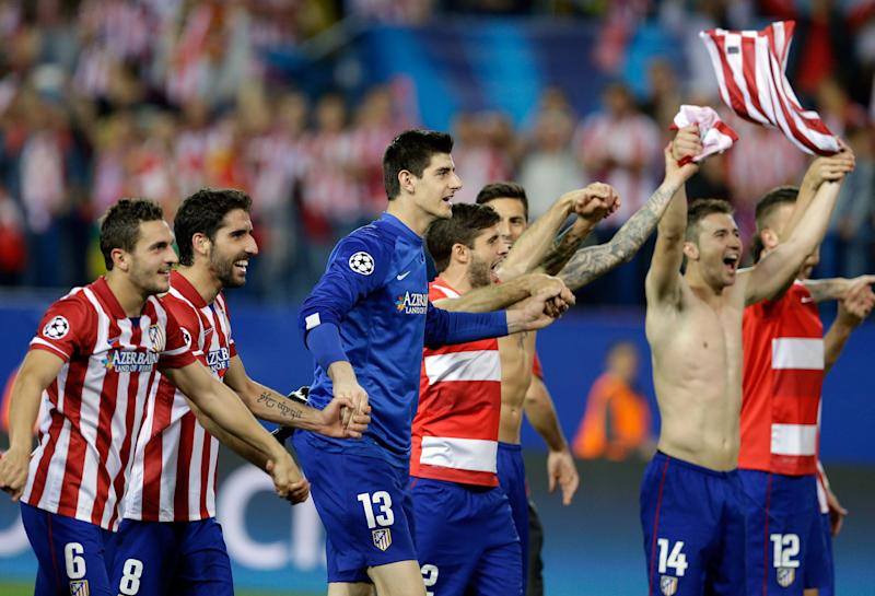 Atletico players celebrate at the end of the Champions League quarterfinal second leg soccer match between Atletico Madrid and FC Barcelona in the Vicente Calderon stadium in Madrid, Spain, Wednesday, April 9, 2014. Atletico defeated Barcelona 1-0. (AP Photo/Paul White)