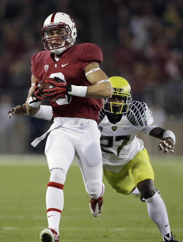 Stanford wide receiver Michael Rector (3) catches a pass as Oregon defensive back Terrance Mitchell (27) dives to tackle him during the first quarter of of an NCAA college football game in Stanford, Calif., Thursday, Nov. 7, 2013. (AP Photo/Jeff Chiu)