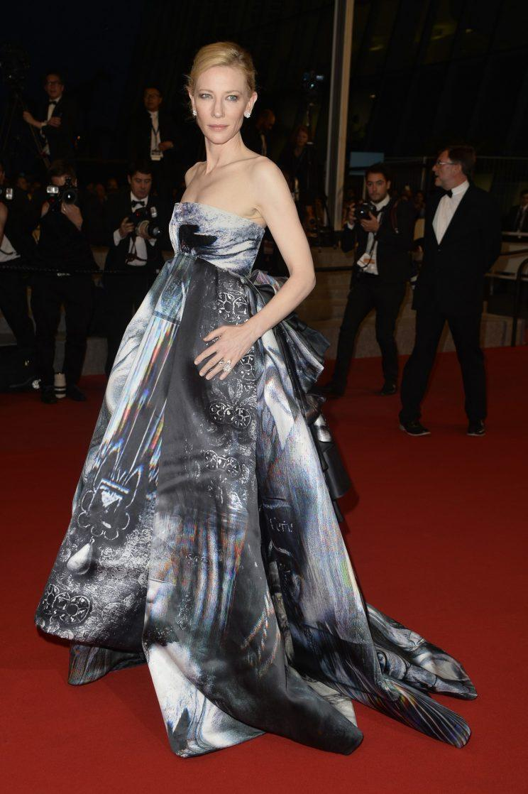 <i>Cate Blanchett caused quite a stir at Cannes in a dramatic Giles Deacon gown [Photo: Getty]</i>