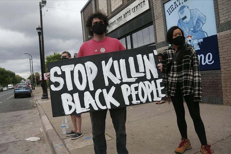 Protesters gather near the site of the death of a man in Minneapolis. Source: AP