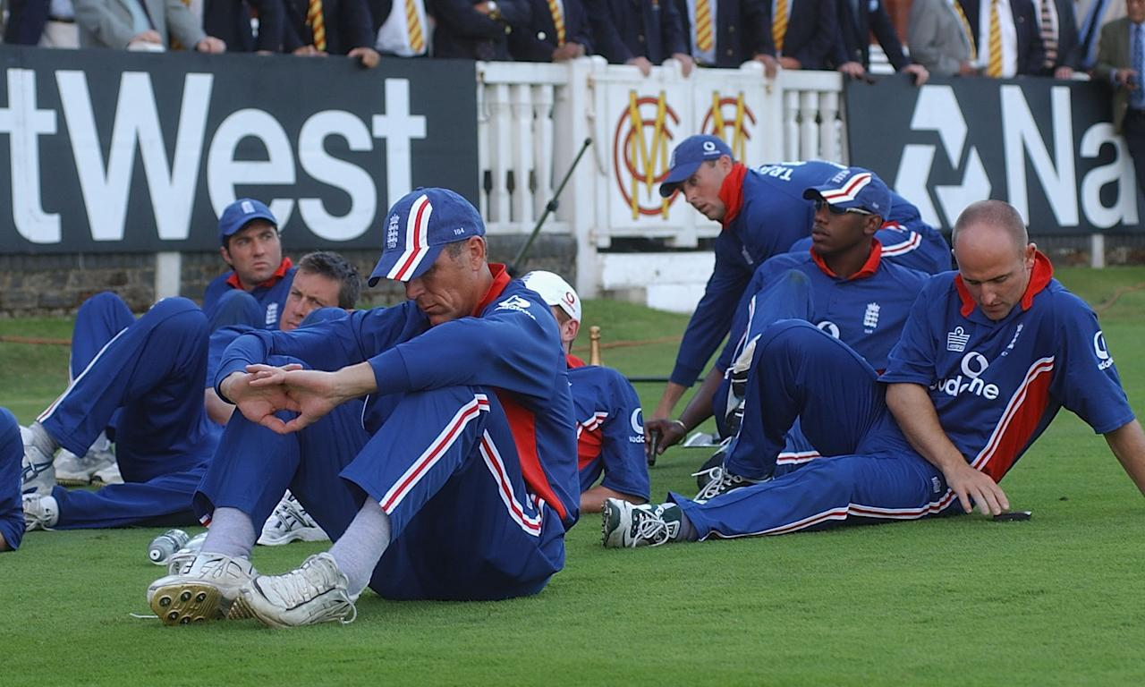 LONDON, ENGLAND - JULY 13:  Dejected England sit on the grass as India recives the Trophy during the match between England and India in the NatWest One Day Series Final at Lord's in London, England on July 13, 2002. (Photo by Tom Shaw/Getty Images)