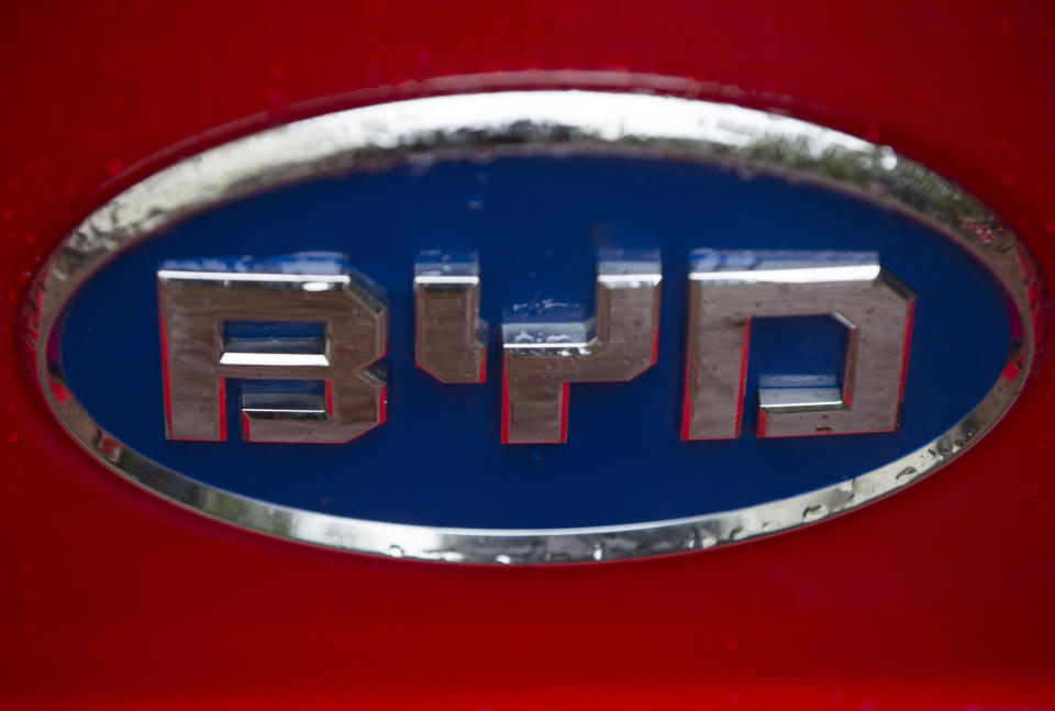 A badge of a BYD bus is displayed at a UK Trade and Investment event in London, Britain October 21, 2015. Chinese investment into low carbon London black cabs and a deal involving luxury sports carmaker Aston Martin are part of a series of business announcements on Wednesday during the state visit by China's president to London. The deals come on the second full day of Xi Jinping's stay as Britain seeks to clinch contracts worth $46 billion. REUTERS/Neil Hall