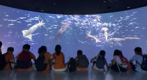 Children watch a multimedia display at the Squid Museum which opened in April 2021 in the eastern Chinese city of Zhoushan. The 2,600-square meter museum showcases information regarding the evolution of squid, squid fishing and processing. The eastern city of Zhoushan is home to China's largest distant water fleet. (AP Photo)