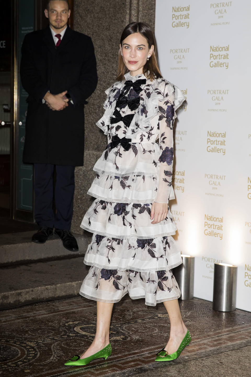 <p>The British model and fashion designer looked as on point as ever in a tiered monochrome gown by Erdem, paired with metallic green pumps. <em>[Photo: Getty]</em> </p>