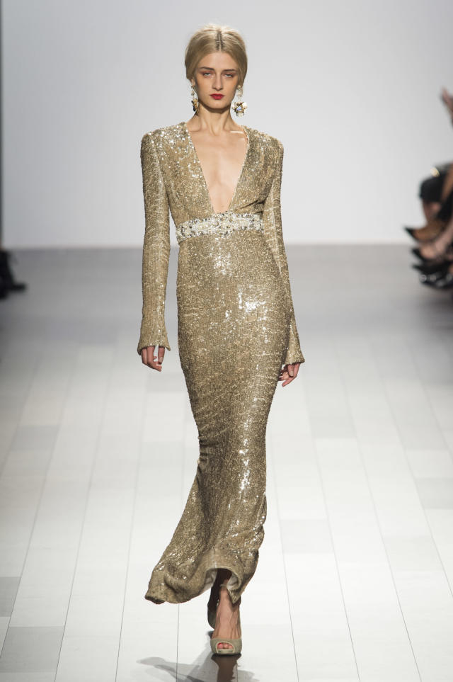 <p><i>Model wears a low-cut gold shimmery dress from the SS18 Badgley Mischka collection. (Photo: ImaxTree) </i></p>