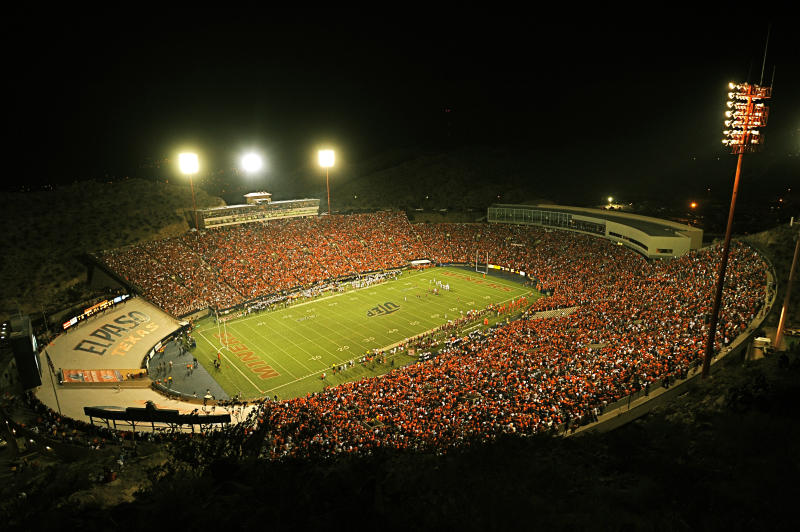 """FILE - In this Sept. 6, 2008, file photo, fans attend a football game at Sun Bowl Stadium in El Paso, Texas. A federal risk assessment of a boxing match that had been cancelled at the Sun Bowl predicted it would draw leaders from two rival drug cartels, but noted the cartels had declared the event a """"neutral zone,"""" a law enforcement official told The Associated Press on Friday, April 27, 2012. (AP Photo/El Paso Times, Ruben R Ramirez, file)"""