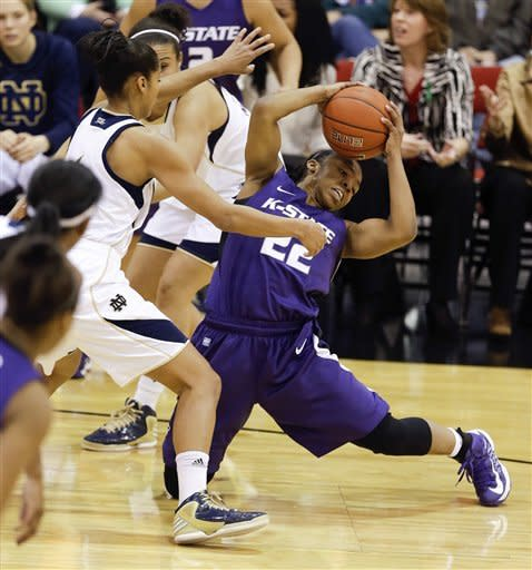 Kansas State's Mariah White (22) is pressured by Notre Dame's Skylar Diggins as she looks to pass during the first half of an NCAA college basketball game, Thursday, Dec. 20, 2012, in Las Vegas. (AP Photo/Julie Jacobson)