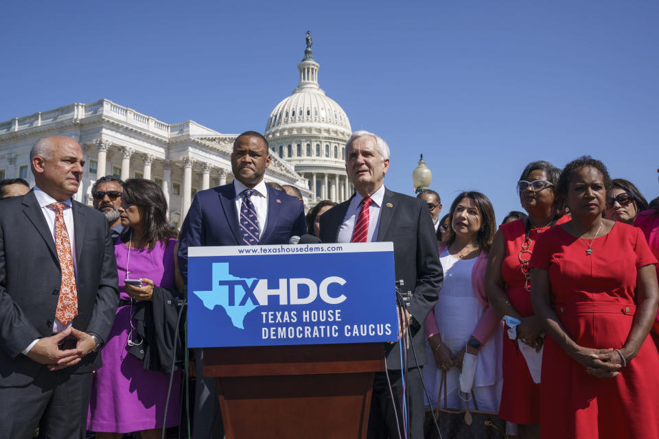 Rep. Marc Veasey, D-Texas, center left, and Rep. Lloyd Doggett, D-Texas, joined at left by Rep. Chris Turner, chairman of the Texas House Democratic Caucus, welcome Democratic members of the Texas legislature at a news conference at the Capitol in Washington, Tuesday, July 13, 2021. The lawmakers left Austin hoping to deprive the Texas Legislature of a quorum — the minimum number of representatives who have to be present for the body to operate, as they try to kill a Republican bill making it harder to vote in the Lone Star State. (AP Photo/J. Scott Applewhite)