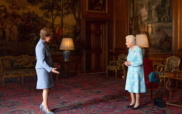 Queen Elizabeth II receives Nicola Sturgeon at the Palace of Holyroodhouse, as part of her traditional trip to Scotland for Holyrood Week. - PA