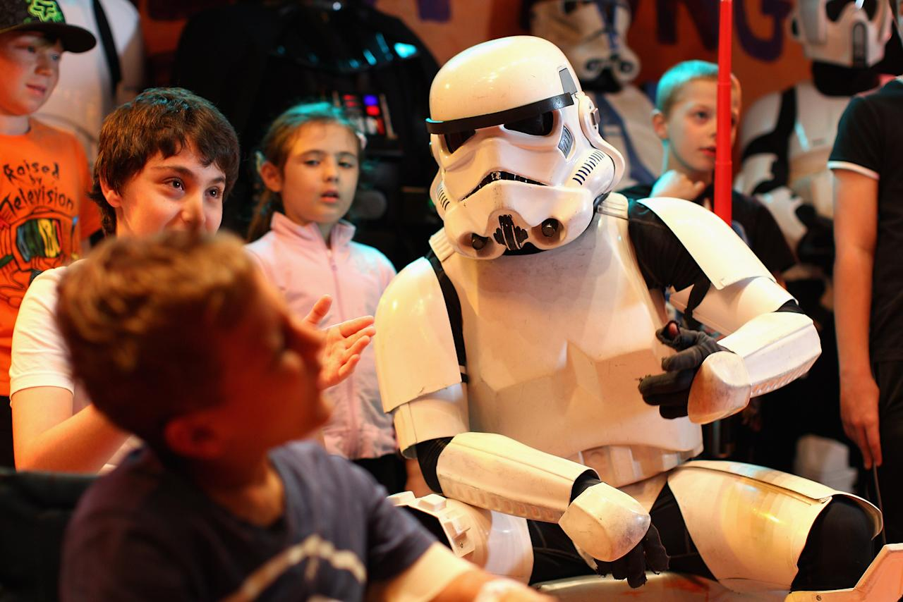 Jacob French talks to patients after completing his trek at the Sydney Children's Hostpital on April 4, 2012 in Sydney, Australia. French today completed the over 5,000 km trek from Perth to Sydney on foot, donning a full body stormtrooper costume he successfully raised over $100,000 for the Starlight Children's Foundation. Since July 2011, Jacob has walked 10 hours a day, Monday to Friday, lost over 12kg in weight, and gone through seven pairs of shoes. The Starlight Children's Foundation provides programs to help lift the spirits of sick children in hospitals accross Australia.  (Photo by Cameron Spencer/Getty Images)