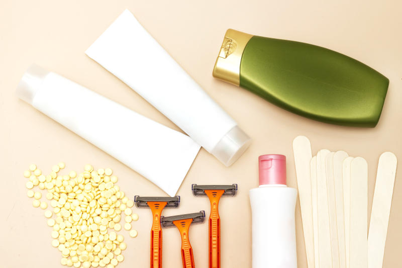 Personal hygiene : yellow wax, wooden stick, shaver and intimate lotion and shampoo