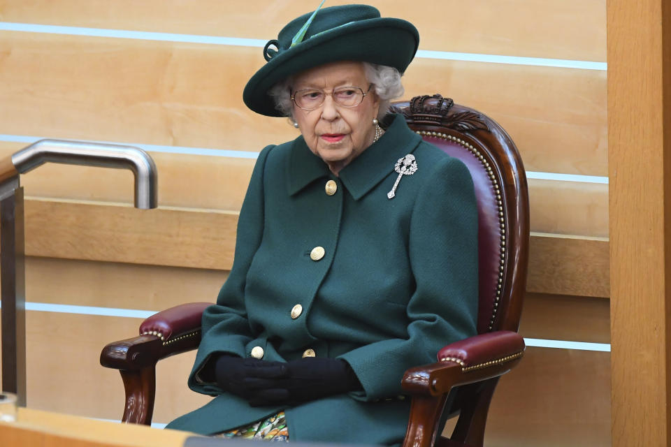 Britain's Queen Elizabeth II sits in the debating chamber to mark the official start of the sixth session of the Scottish Parliament, in Edinburgh, Scotland, Saturday, Oct. 2, 2021. (Andy Buchanan/Pool Photo via AP)