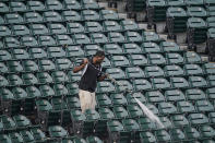 A worker cleans the stadium before baseball's Game 4 of the American League Division Series between the Chicago White Sox and the Houston Astros was postponed Monday, Oct. 11, 2021 in Chicago. (AP Photo/Charles Rex Arbogast)