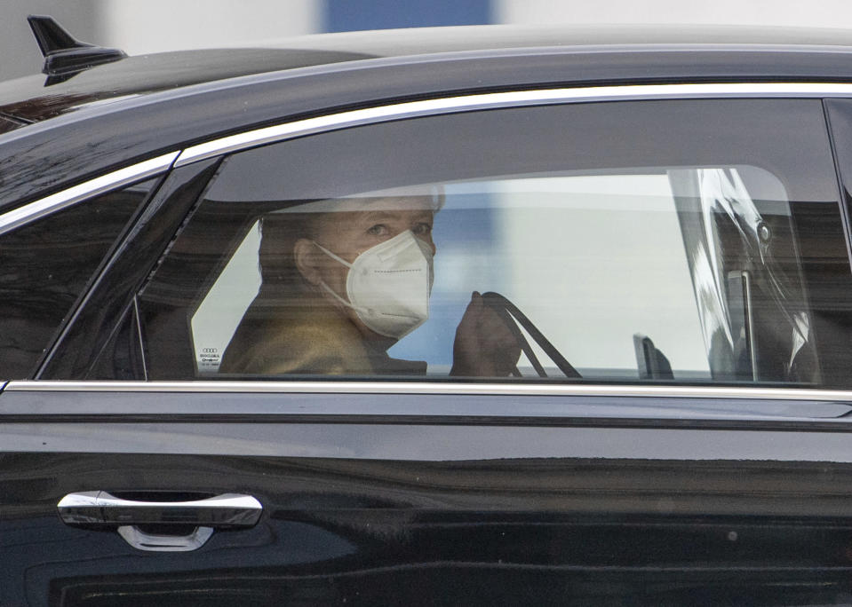 Federal Chancellor Angela Merkel arrives in front of the Bundestag, Berlin, Germany, Thursday, Feb.11, 2021. She delivers a government statement on the results of the federal-state round on the management of the Corona pandemic. (Dorothee Barth/dpa/dpa via AP)