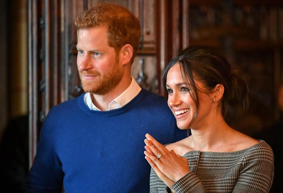 Prince Harry and Meghan Markle watch a performance by a Welsh choir in the banqueting hall during a visit to Cardiff Castle on 18 January 2018 (Getty Images)