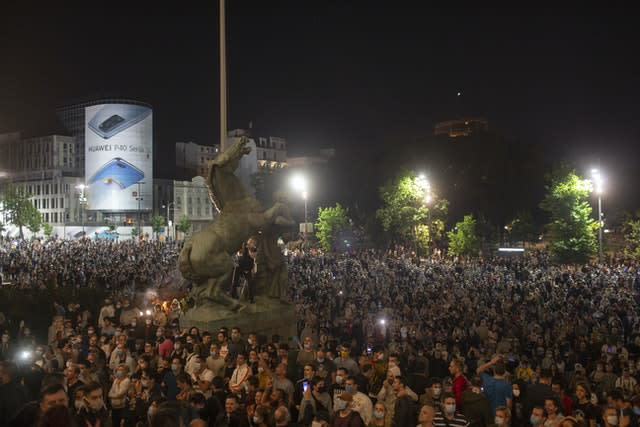 Protesters gather in Belgrade (Marko Drobnjakovic/AP)