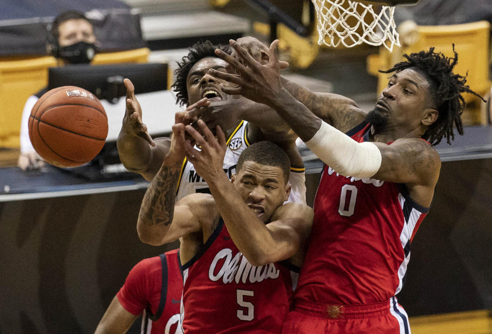 Mississippi's Romello White, right, and KJ Buffen, center, and Missouri's Kobe Brown, left, vie for a rebound during the second half of an NCAA college basketball game Tuesday, Feb. 23, 2021, in Columbia, Mo. (AP Photo/L.G. Patterson)
