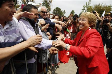 Chilean presidential candidate Michelle Bachelet greets supporters during a campaign event in Santiago