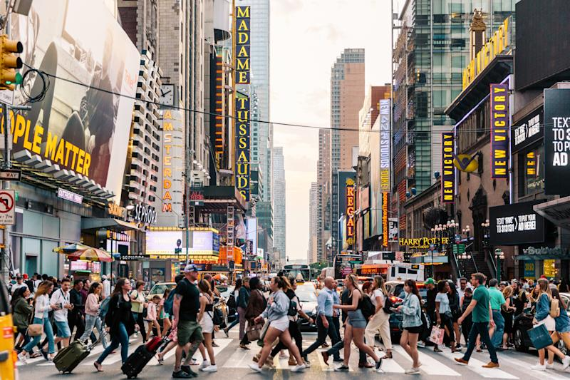 Crowds of people crossing street on zebra crossing in New York, USA. PHOTO: Getty