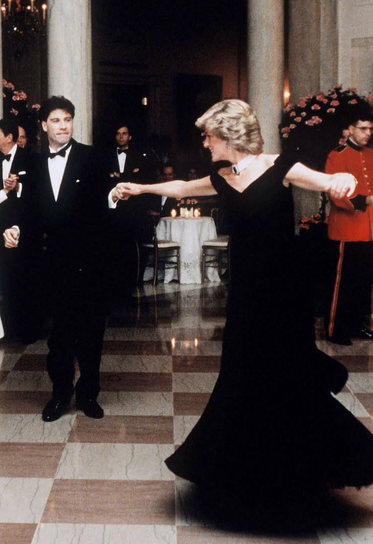 It wouldn't be a royal tour retrospective without a photograph of Princess Diana dancing with John Travolta. For a starry evening at the White House, the royal wore a Victor Edelstein cold-shoulder gown which fetched for £240,000 at auction in 2013. <em>[Photo: Getty]</em>