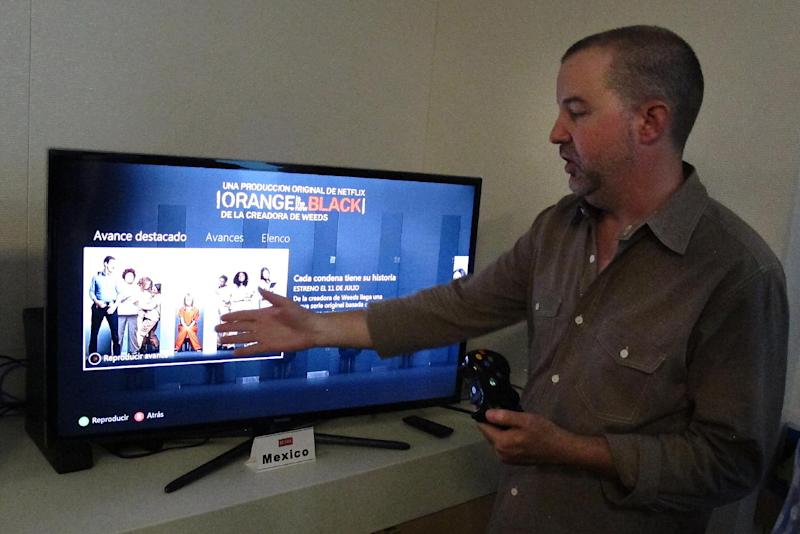 """In this photo taken Wednesday, July 10, 2013, Chris Jaffee, Netflix VP of Product Innovation, debuts the new series """"Orange is the new black"""" in Los Gatos, Calif. (AP Photo/Michael Liedtke)"""