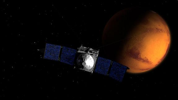 MAVEN, NASA's newest Mars orbiter, is shown near the Red Planet in this artist's illustration. The spaceraft, which launched in November 2013, will arrive at Mars on Sept. 21, 2014.