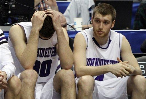 Northwestern forward Davide Curletti, left, and guard Alex Marcotullio react in the overtime of an NCAA college basketball game against Minnesota at the Big Ten Conference tournament in Indianapolis, Thursday, March 8, 2012. Minnesota won 75-68 in overtime. (AP Photo/Kiichiro Sato)