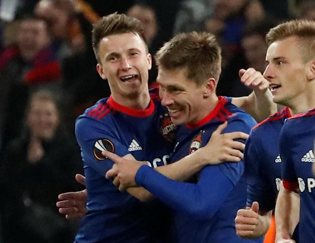 Soccer Football - Europa League Quarter Final Second Leg - CSKA Moscow v Arsenal - VEB Arena, Moscow, Russia - April 12, 2018 CSKA Moscow's Kirill Nababkin celebrates with Aleksandr Golovin after scoring their second goal REUTERS/Grigory Dukor