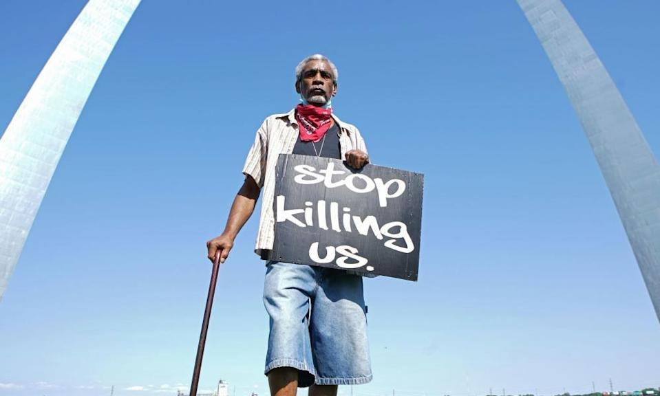 A man holds a sign in St Louis, Missouri at a George Floyd protest in June last year.