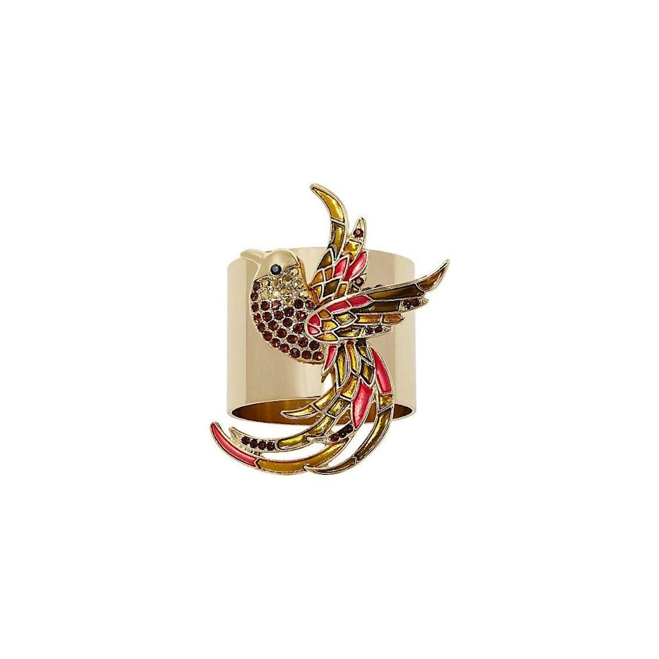 """Bring some sparkle to the dinner table with these one-of-a-kind embellished napkin rings. $80, One Kings Lane. <a href=""""https://www.onekingslane.com/p/4854028-s-2-joyful-bird-napkin-rings-gold-multi.do?"""" rel=""""nofollow noopener"""" target=""""_blank"""" data-ylk=""""slk:Get it now!"""" class=""""link rapid-noclick-resp"""">Get it now!</a>"""